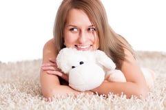 Beautiful young blond woman wearing pajamas Stock Images