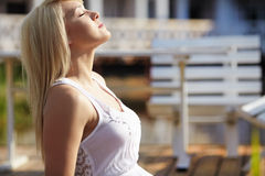 Beautiful young blond woman in white blouse Stock Photo