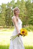 Beautiful young blond woman in white dress Royalty Free Stock Photography