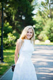 Beautiful young blond woman. In a white dress outdoors Royalty Free Stock Photo