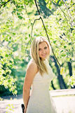 Beautiful young blond woman. In a white dress outdoors Royalty Free Stock Images