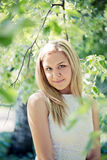 Beautiful young blond woman. In a white dress outdoors Stock Photography