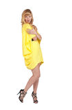 Beautiful young blond woman in yellow dress Royalty Free Stock Photo