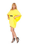 Beautiful young blond woman in yellow dress Stock Image