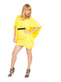 Beautiful young blond woman in yellow dress Stock Photos