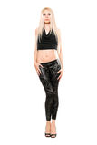 Beautiful young blonde in black leggings Royalty Free Stock Photo