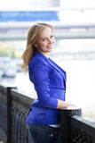 Beautiful young blonde in a blue jacket Stock Photos
