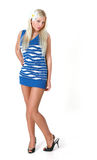 Beautiful young blonde in blue stocking dress Royalty Free Stock Photos