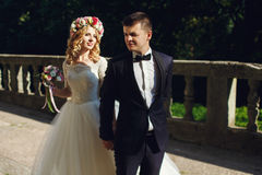 Beautiful young blonde bride in white dress with handsome groom Royalty Free Stock Photo