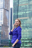 Beautiful young blonde calling by phone Royalty Free Stock Photo