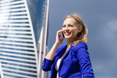 Beautiful young blonde calling by phone Royalty Free Stock Images