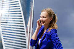Beautiful young blonde calling by phone Stock Photo