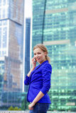 Beautiful young blonde calling by phone Royalty Free Stock Photography