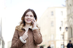 Beautiful young blonde calling by phone Stock Images