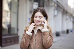 Beautiful young blonde calling by phone Stock Photos