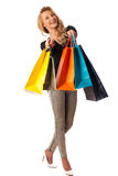 Beautiful young blonde caucasian woman holding vibrant shopping Stock Image