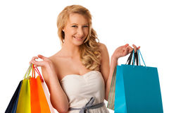 Beautiful young blonde caucasian woman holding vibrant shopping Royalty Free Stock Photo