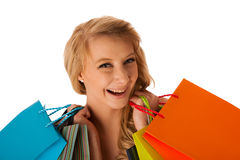 Beautiful young blonde caucasian woman holding vibrant shopping Royalty Free Stock Images