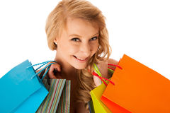 Beautiful young blonde caucasian woman holding vibrant shopping Stock Photography