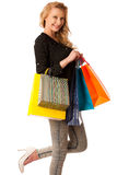 Beautiful young blonde caucasian woman holding vibrant shopping Royalty Free Stock Image