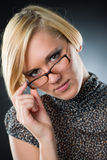 Beautiful young blonde with eyeglasses  Royalty Free Stock Images