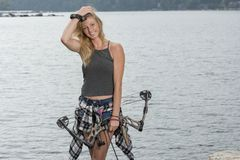 Beautiful young blonde female archer with compound bow Stock Image