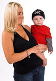 Beautiful young, blonde, female holding her son Royalty Free Stock Photography