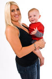 Beautiful young, blonde, female holding her son Stock Photo