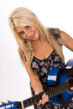 Beautiful young blonde female playing a guitar Stock Images