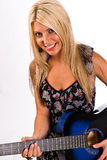 Beautiful young blonde female playing a guitar Royalty Free Stock Image