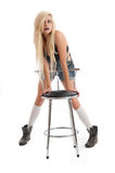 Beautiful young blonde female with stool Royalty Free Stock Photo