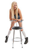 Beautiful young blonde female with stool Stock Image