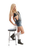 Beautiful young blonde female with stool Royalty Free Stock Image