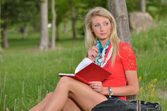 Beautiful young blonde female student Royalty Free Stock Photo