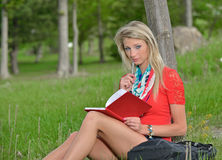 Beautiful young blonde female student Stock Photography