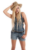 Beautiful young blonde female wearing staw hat Royalty Free Stock Image