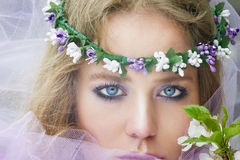 Beautiful young blonde girl in blooming trees Stock Photos