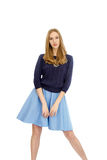 Beautiful young blonde girl in blue dress and blouse Stock Photos