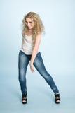Beautiful young blonde girl dancing. Stock Image