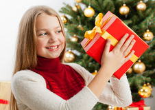 Beautiful young blonde girl holds present Stock Images
