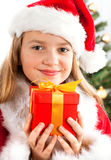 Beautiful young blonde girl holds present Stock Photos