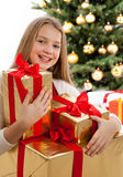 Beautiful young blonde girl holds presents Stock Images