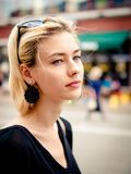 Beautiful young blonde girl is looking at camera. royalty free stock photos