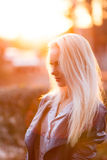 Beautiful young blonde girl with a pretty smiling face and beautiful eyes. A woman with long hair dispels their, amazing looks. Stock Image