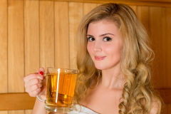 Beautiful young blonde with a glass of beer Royalty Free Stock Photography