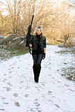 Beautiful young blonde with a gun Royalty Free Stock Photos