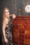 Beautiful young blonde haired woman opens drawer Royalty Free Stock Photos