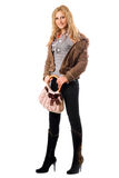 Beautiful young blonde with a handbag. Isolated Stock Photography
