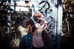 Beautiful young blonde hipster woman listening music Royalty Free Stock Images