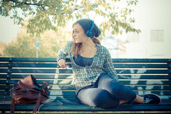 Beautiful young blonde hipster woman listening music Royalty Free Stock Image